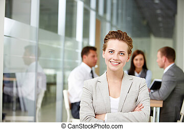 Successful boss - Happy businesswoman looking at camera on ...