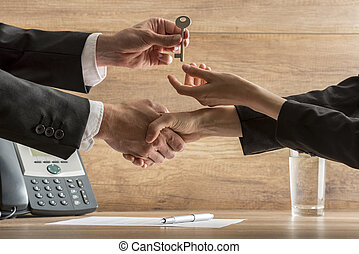 Successful business deal - real estate agent and new female...