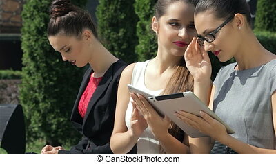 Successful business girls are browsing business terms on the tablet