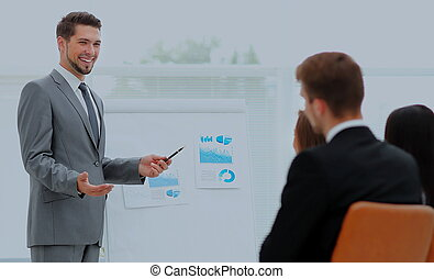 Successful business man at the office leading a group -...