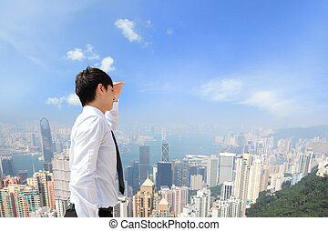 Successful business man looking away with city