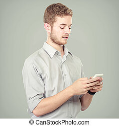 Successful business man using mobile phone