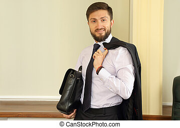 successful business man with a briefcase and suit in the hands