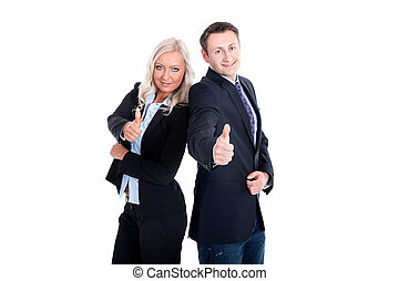 Successful business partners showing thumbs up