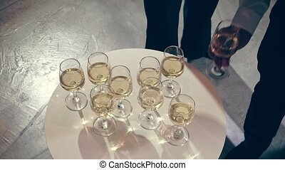 Successful business people drink wine and champagne with team members in ball room to celebrate business project to launch new product to market. Corporate business and people networking concept.