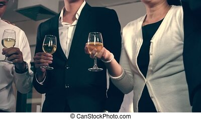 Successful business people drink wine and champagne in ball ...