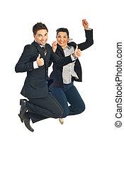 Successful business people jump
