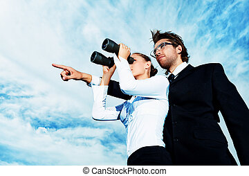 purpose - Successful business people standing over blue sky...