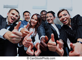 Successful business people with thumbs up and smiling.