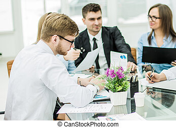 successful business team discussing a new contract at the workpl