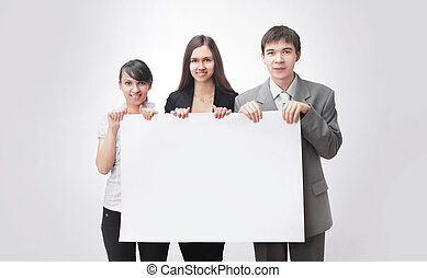 successful business team holding a blank banner.