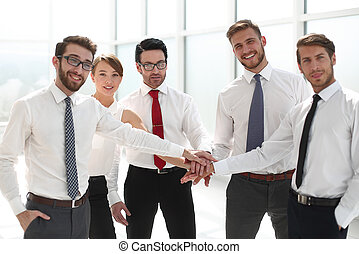 successful business team holding hands