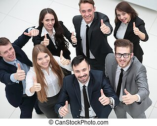 successful business team holding up a thumbs up -...