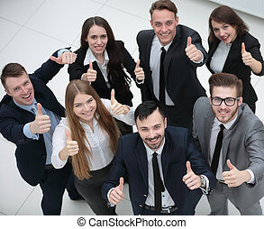 successful business team holding up a thumbs up