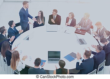 successful business team sitting at a round table and...