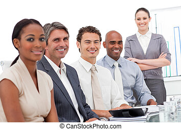 Successful business team smiling at the camera in a meeting