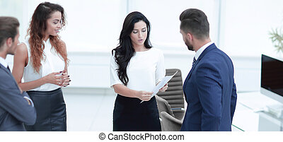 business team talking, standing in office