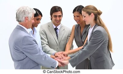 Successful business team together doing high-fives and...