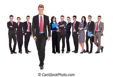 business team with a business man walking forward