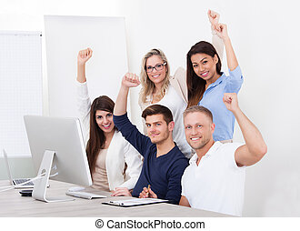 Successful Business Team With Arms Raised