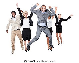 Successful Business Team With Arms Raised Over White...