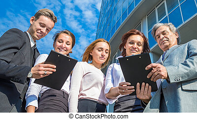 successful business team with tablets on a background in the office