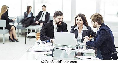 successful business team working on laptop and making the current financial report