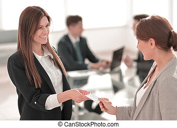 successful business woman gives her business card