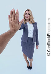 successful business woman giving a high five