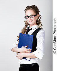 Successful business woman in a business suit and glasses holding folder