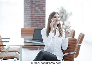 business woman talking on mobile phone sitting in the office