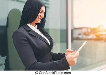 Successful business woman working with tablet in an urban setting