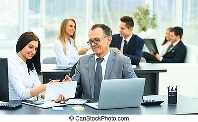 businessman and his assistant discuss