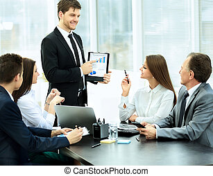 successful businessman and his business team meeting in a modern office.