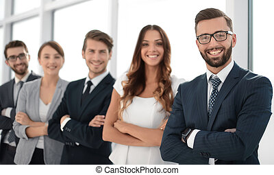 successful businessman and his business team standing in a row