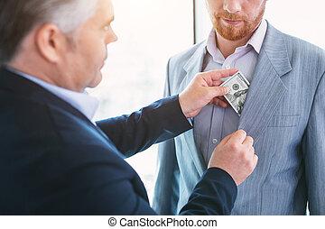 Successful businessman giving a bribe