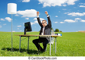 Successful businessman - Happy businessman raising his arms...