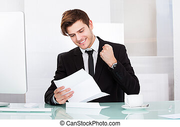 Successful Businessman Holding Paper