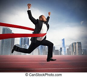 Successful businessman in a finishing line - Success of a ...