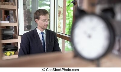 Successful businessman in glasses thinking about something....