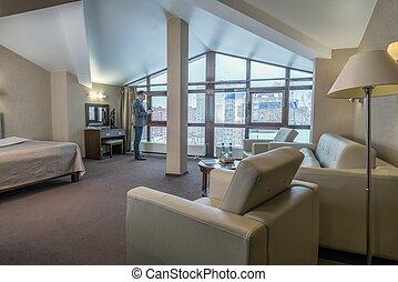 Successful businessman in luxury hotel room