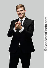 successful businessman making a welcoming gesture