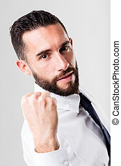successful businessman on a white background with beard