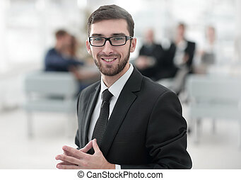 successful businessman on blurred background business team.