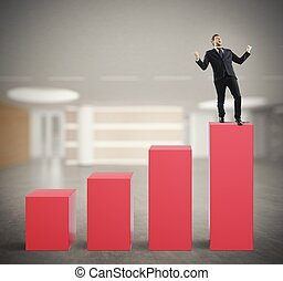 Successful businessman on the top of a statistic bar