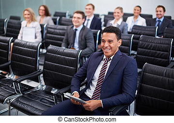 Successful businessman - Image of business partners sitting...
