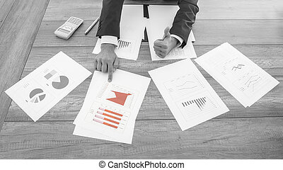 Successful businessman pointing to a chart