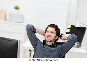 Successful businessman relaxing in his chair