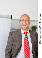 successful businessman standing by flipchart