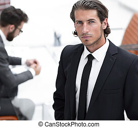businessman standing in his office